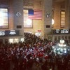 Grand Central Station flooded with Santas