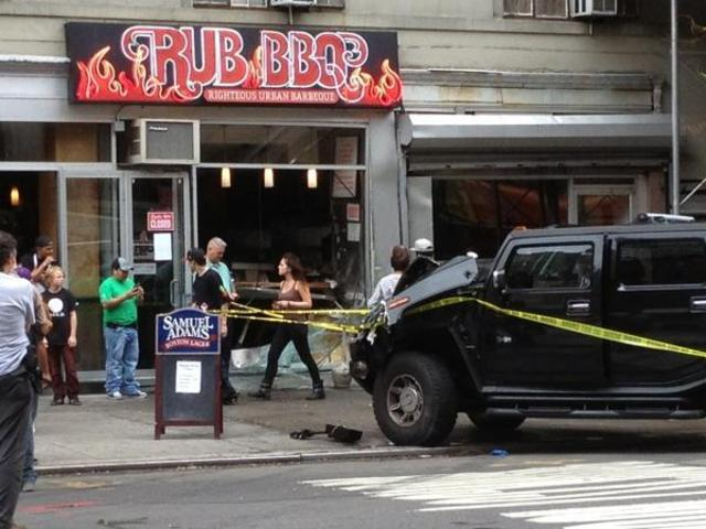 Hummer crashes into the Rub BBQ storefront