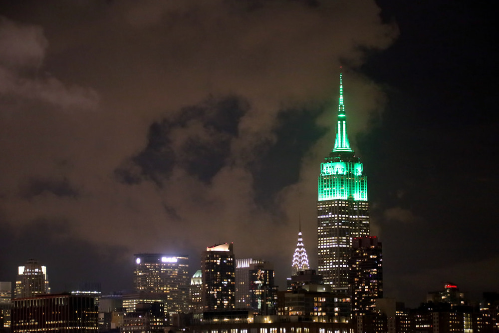 Surrounded by clouds, the Empire State Building is lit green in honor of The Climate Group and Climate Week NYC.