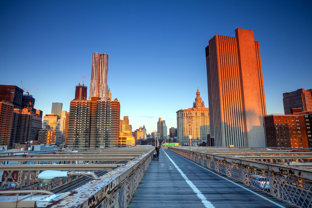 Lower Manhattan through Brooklyn Bridge at sunset, New York City