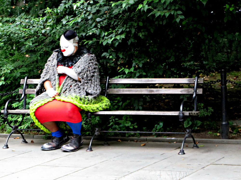Napping clown, City Hall Park, New York City.